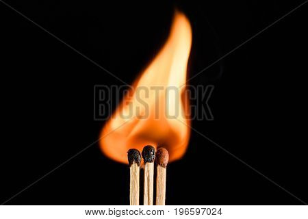 Three The Flaring Match Isolated On Black Background