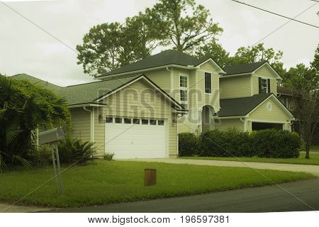 Jacksonville Florida, USA - July 18, 2017: Custom built luxury house with nicely trimmed front yard and Private car garage, lawn in a residential neighborhood at Jacksonville beach area