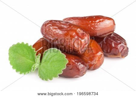 Dates with mint leaves isolated on white background.