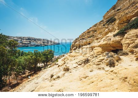 Matala Beach. Caves On The Rocks Were Used As A Roman Cemetery And At The Decade Of 70's Were Living