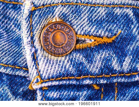 Russia Kamchatka - JULY 17- 2017: Close up original vintage Levi Strauss metal button of 1937 Levi's 503BXX . LEVI'S is a brand name of Levi Strauss and Co founded in 1853.