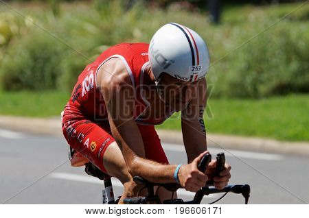 NICE - JULY 27 2017 : IRONMAN Nice 2017. Competitor at the end of the 180 km bike tour.Christophe QUARTIER (293) finishing the bike tour.