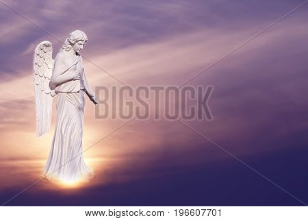 Angel sculpture on beautiful sky background concept of Religion