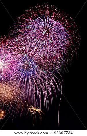 New Year's Eve fireworks on dark sky background