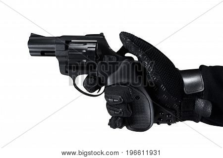 Hand in tactical black gloves holding a revolver black gun profile view.