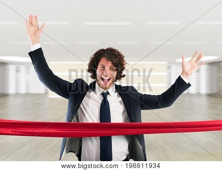 Businessman goes beyond the red ribbon at the arrival of a race