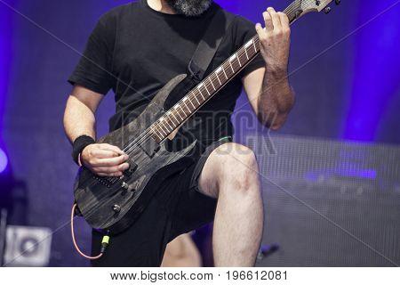 Guitarist on stage, night entertainment.