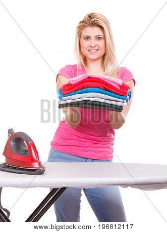 Household duties perfect housewife concept. Woman holding pile of folded clothes after laundry and ironing