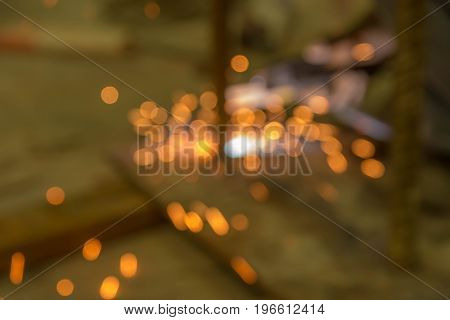 Abstract light background of sparks from welding with bokeh.