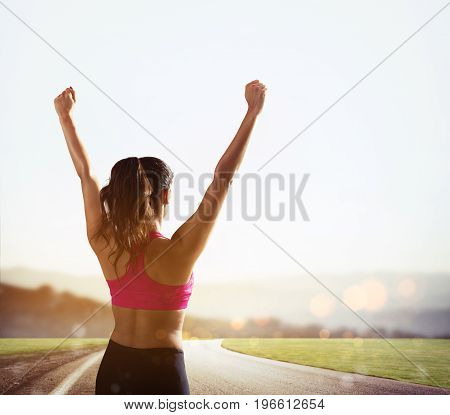 Young woman enjoys the freedom and joy of living outdoors