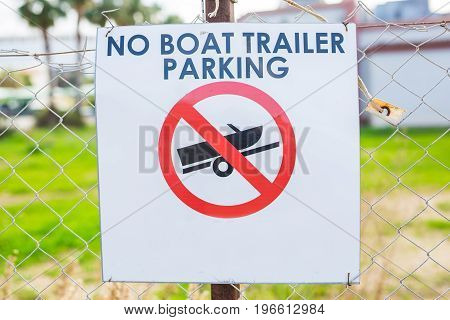 No Boat Trailer Parking Sign in the street