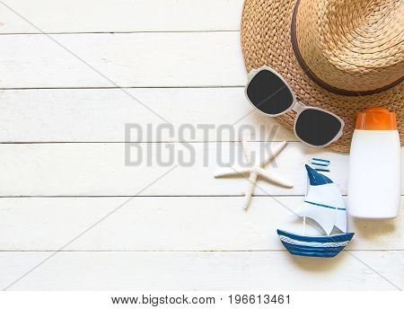 Summer Fashion woman big hat and accessories in the beach. Tropical sea.Unusual top view colorfull background. Summer Concept.
