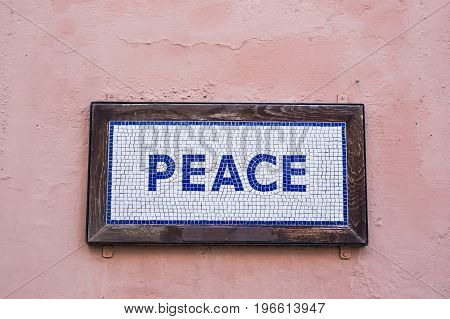 Word peace on signboard. Concept of peace of mind