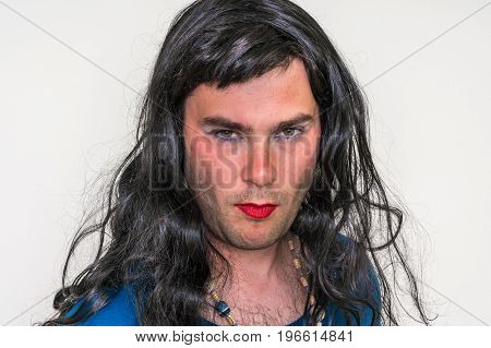 Bearded Man Wearing Makeup And Female Dress