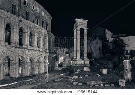 Theatre with historical ruins at night in Rome, Italy