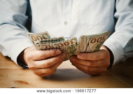 Man count money cash in his hand. Economy, saving, salary and donate concept.