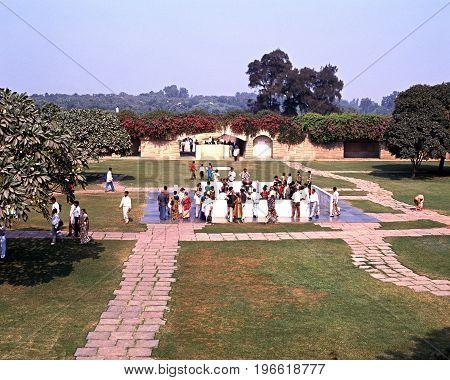 DELHI, INDIA - NOVEMBER 20, 1993 - People in the gardens of the memorial to Mahatma Gandhi Delhi Delhi Union Territory India, November 20, 1993.