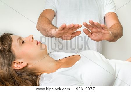 Woman Getting Reiki Healing Therapy - Alternative Medicine