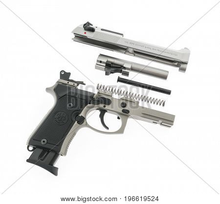 Loei, Thailand - JULY 10, 2016: A 9mm Beretta M92FS semi-automatic handgun used by both police and military on white background
