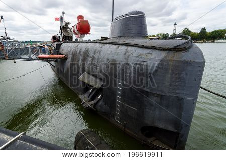 PEENEMUENDE GERMANY - JULY 18 2017: The Peenemuende seaport on the Baltic Sea island of Usedom and the Soviet Juliett-class submarine K-24 (U461).