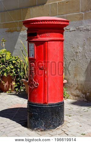 VITTORIOSA, MALTA - MARCH 31, 2017 - Traditional red British post box Vittoriosa Malta Europe, March 31, 2017.