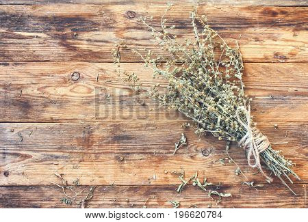 bunch of dry herb wormwood tied with rope on a wooden table rustic style