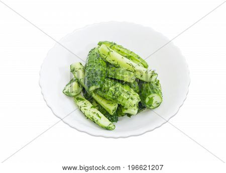 Lightly salted cucumber on the white dish on a white background