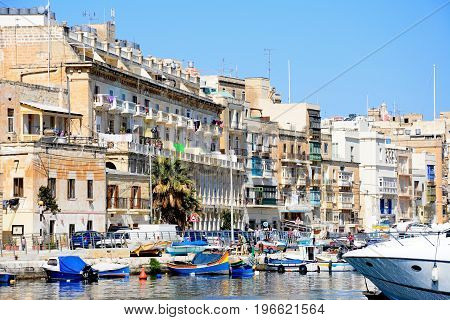 SENGLEA, MALTA - MARCH 31, 2017 - View of the Senglea waterfront with traditional Maltese Dghajsa water taxi boats moored in the harbour Vittoriosa Malta Europe, March 31, 2017.