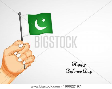illustration of hand holding Pakistan flag with Happy defence Day text on the occasion of Pakistan defence day