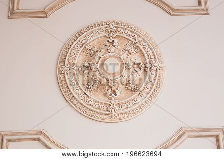 decoration item made of beige plaster. relief stucco interior.