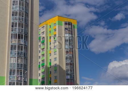 Apartment building.Multistoried modern and stylish living block of flats. Real estate. New house. Real Estate