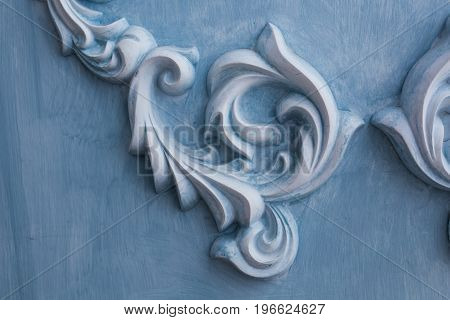 decoration item made of blue plaster. relief stucco interior.