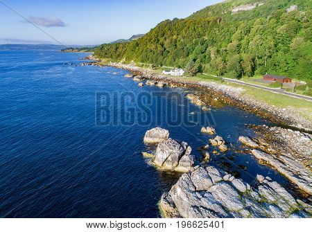 The eastern coast of Northern Ireland and Antrim Coastal Road a.k.a. Causeway Coastal Route. Aerial view at sunrise