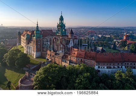 Wawel Hill with historic royal Wawel cathedral and castle in Krakow, Poland.  Aerial view in sunrise light