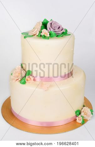 Large cake on white is shot vertically in the studio