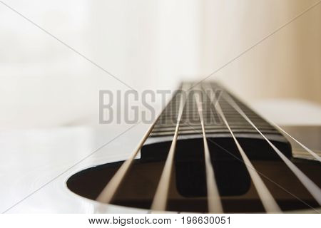 Selective focus, macro lens, shooting retro classic vintage guitar, focus on strings