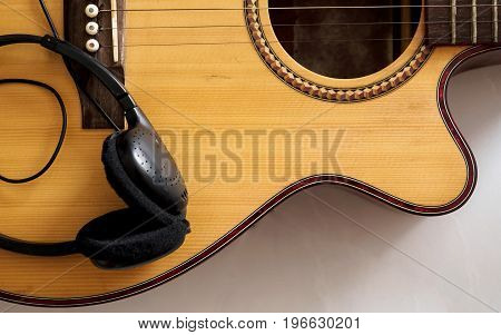 Acoustic guitar close up with ear phone