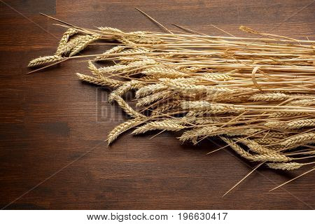 Wheat Ears on the Wooden Table. Harvest concept .