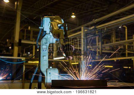 Robot is welding part in automotive factory