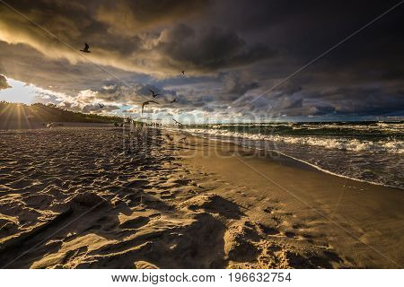 Seascape with dark dramatic stormy cumulonimbus cloud formation over the beach at Baltic sea Poland.