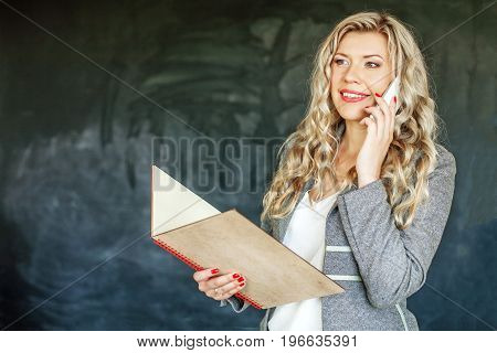 Successful Woman talking on phone. Student Concept of education and education.