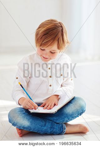 Cute Kid, Boy Making Notes In Diary At Sunny Day