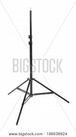 A long tripod. Modern powerful photography flash. Studio lighting, isolated on the white background. Professional black equipment. Studio photography video light. Equipment for a photo studio.