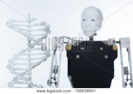 Plastic prototypes. White artificial special equipment for studying the genome standing in front of the robot in a lab
