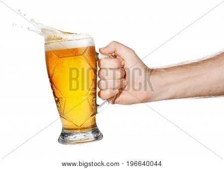 hand with mug of splashing beer isolated on white background. Male hand holding mug of light beer toasting. Hand making toast