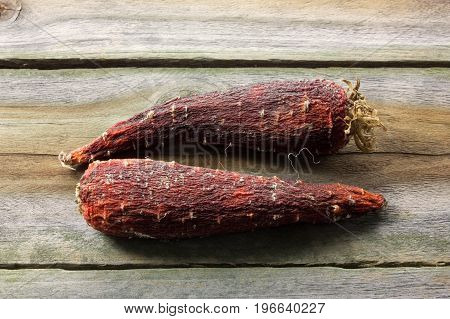 Bad Rotten Carrots on a Wooden Background