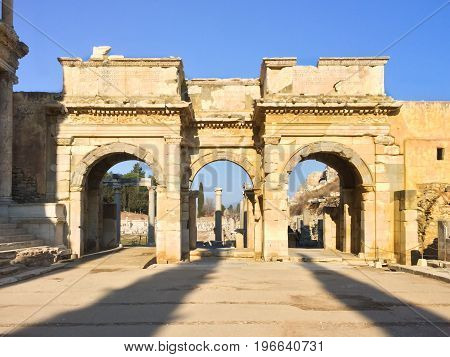 Roman Gate Arc Ruins With Stone Columns Row In Ephesus Archaeological Site In Turkey