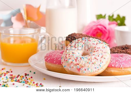 American donuts with milk on white dish.