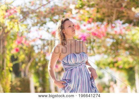 Summertime, nature, vacation and people concept - Portrait of young woman looking away outdoor
