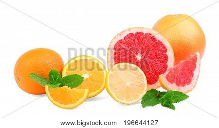 A rich assortment of colorful citruses isolated on a white background. Juicy red grapefruits, bitter yellow lemons and sweet oranges. Fresh mint leaves. Exotic and tropical summer fruits.